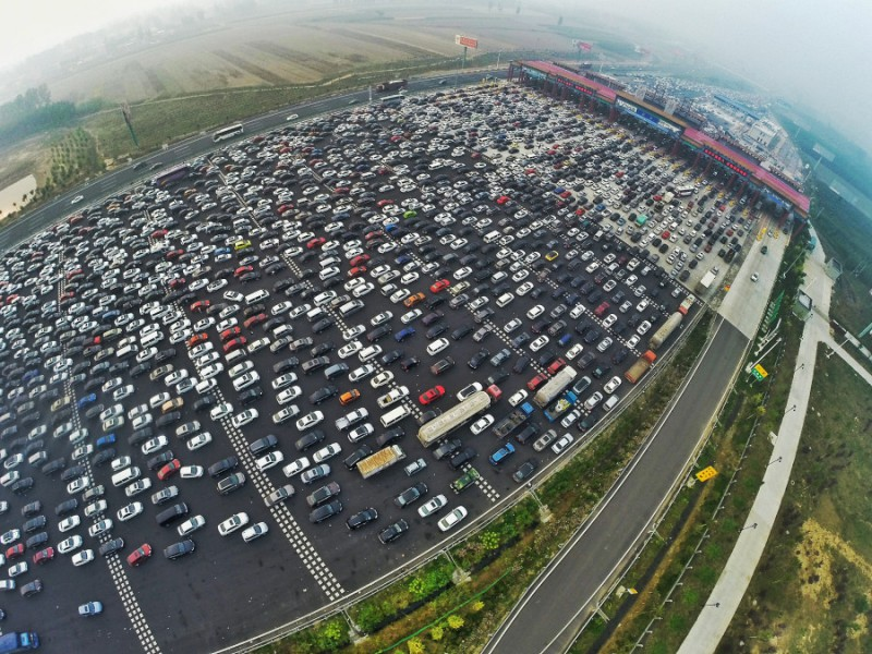 BEIJING, CHINA - OCTOBER 06:  (CHINA OUT) (EDITORS NOTE: Image captured with a fisheye lens) Aerial view of cars queuing up to pass a checkpoint set recently in the direction of Beijing on the Beijing-Hong Kong-Macau Expressway at the end of National Day Holiday on October 6, 2015 in Beijing, China. A travel peak appeared at the end of 7-day China's National Day Holiday.  (Photo by ChinaFotoPress/ChinaFotoPress via Getty Images)