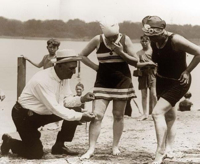 20.-An-beach-official-measures-bathing-suits-to-ensure-they-arent-too-short-1920s